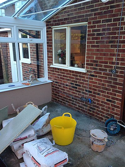 Plastering interior walls in a conservatory